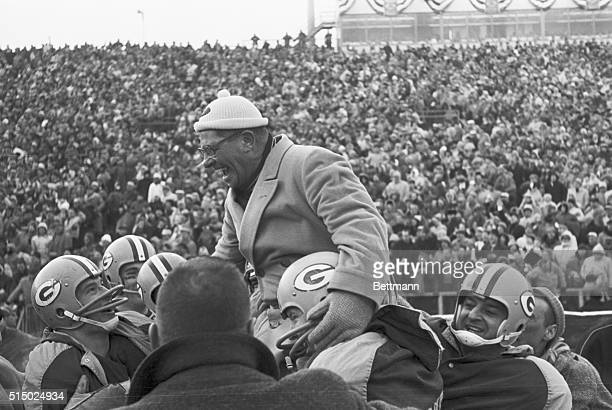 Packer coach Vince Lombardi is all grins as players start to lift him to their him to their shoulders after routing the New York Giants 370 for...