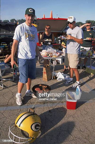 Packer fans have a tailgate barbeque party before the game between the Green Bay Packers and the Cleveland Browns at Lambeau Field on August 262002...