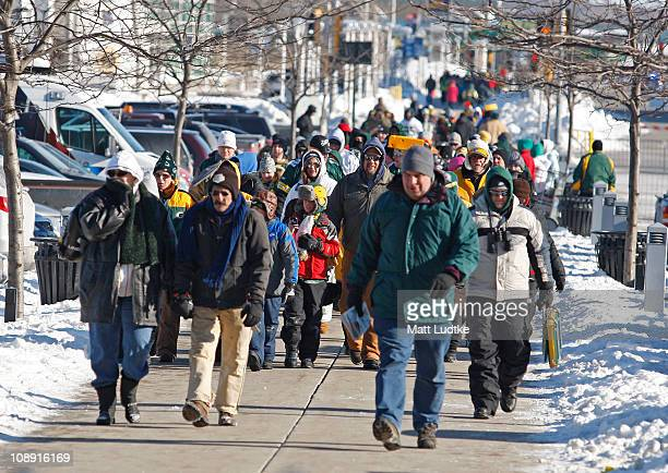 Packer fans make their way to Lambeau Field for the Green Bay Packers Super Bowl XLV victory ceremony on February 8 2011 in Green Bay Wisconsin