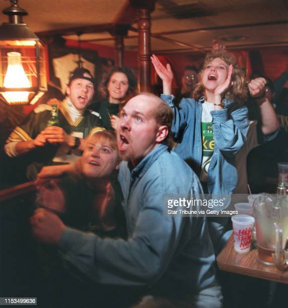 Packer fans watched the Sunday afternoon game between Greenbay and the Dallas Cowboys at Gabe's by the Park a StPaul bar In front are Mary Zinnecker...