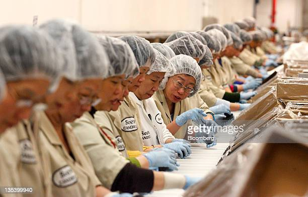Packers fill boxes with candy at the See's Candies Inc packing facility in South San Francisco California US on Thursday Dec 8 2011 Brad Kinstler...