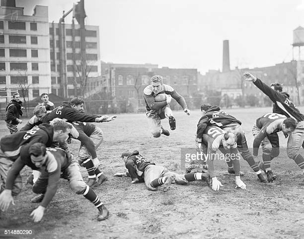 Packers Train For Clash With Giants Clark Hinkel coming through an opening in the line during a scrimmage of the Green Bay Packers at the Polo...