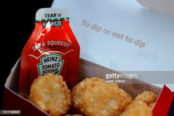 Packet of Heinz ketchup is displayed with Chick-fil-A hash browns on April 12, 2021 in Novato, California. Packets of ketchup are in short supply as...