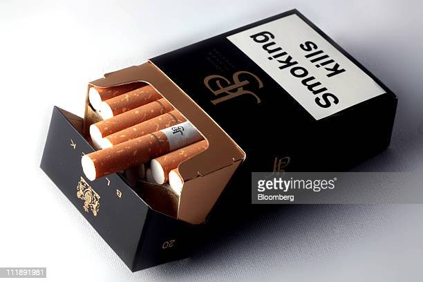 A packet of John Player cigarettes produced by Imperial Tobacco Group Plc sit arranged for a photograph in London UK on Thursday April 7 2011 The...