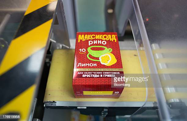 A packet of MaxycolRhino powder moves along the production line at OAO Pharmstandard's Leksredstva drug manufacturing unit in Kursk Russia on Friday...