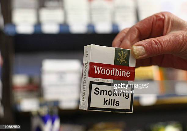 A packet of Woodbine cigarettes are held at James Harvie Tobacconist on March 23 in Paisley Scotland The Chancellor is expected to implement further...