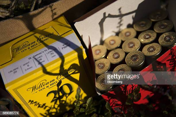 Packets of 12 and 20 bore shotgun cartridges manufactured by by William Evans sit on the ground during a walked up grouse shoot on Egton High Moor in...