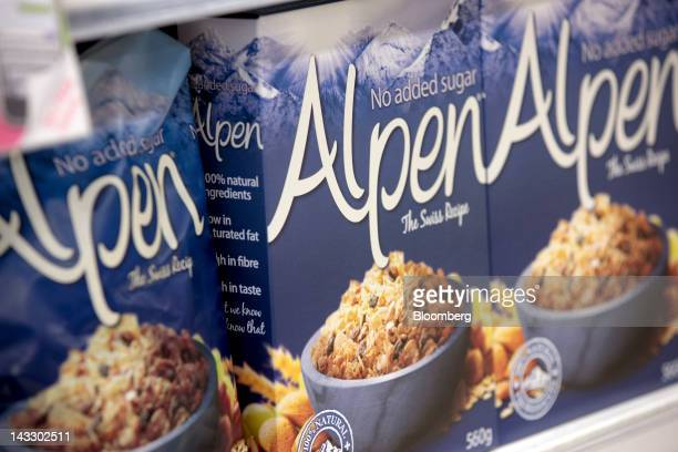 Packets of Alpen breakfast cereal produced by Weetabix Ltd sit on a shelf inside a supermarket in Slough UK on Monday April 23 2012 Bright Food Group...