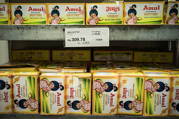 Packets of Amul butter are displayed on the refrigerated shelves of a Bharti Walmart Pvt Ltd Best Price Modern Wholesale store in Zirakpur on the...