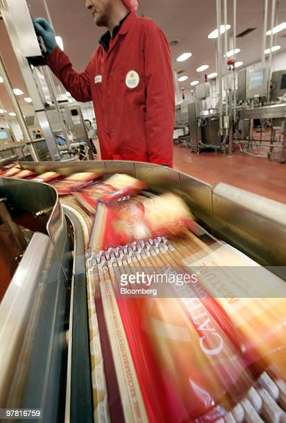 Packets of Catherdral City cheese move along the production line at the Dairy Crest factory in Nuneaton UK on Wednesday March 17 2010 Dairy Crest...