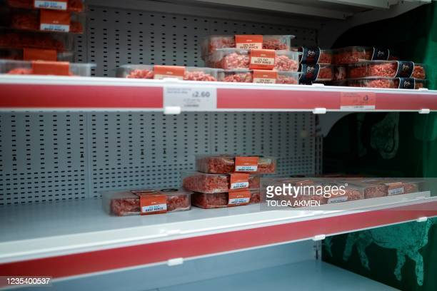 Packets of chilled beef mince are pictured on a half-empty refrigerated meat display at a Sainsbury's supermarket store in Walthamstow, east London,...