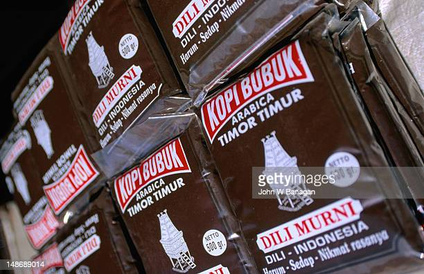 packets of locally grown coffee (kopi) at a dili market. kopi is a favourite drink of the east timorese. - coffee drink stock pictures, royalty-free photos & images