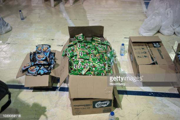 Packets of Milo chocolatemalt drink sit in a box at a makeshift disaster relief operations center ahead of Typhoon Mangkhut's arrival in Tuguegarao...