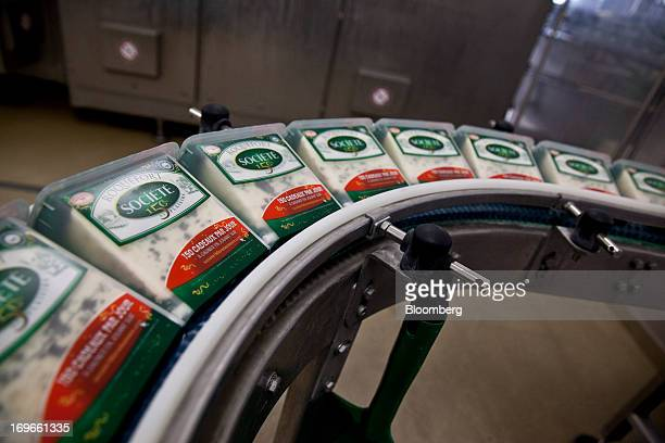 Packets of Roquefort Societe 150years cheese pass along the packaging line at the LebrouRoquefort plant part of Groupe Lactalis SA in Roquefort...
