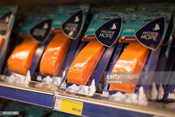 Packets of salmon filets sit for sale inside a Metro Cash Carry store the Russia unit of Metro AG in Moscow Russia on Friday Aug 29 2014 Metro Cash...