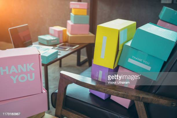 packing accessories at workplace of startup small business owner. - returning merchandise stock pictures, royalty-free photos & images