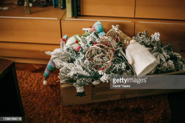 packing christmas decoration in january.xmas are over - endopack stock pictures, royalty-free photos & images