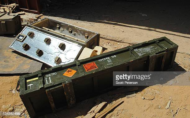 Packing crates lie empty of Libya's sophisticated Russianmade SA24 and other shoulderfired surfacetoair missiles which have disappeared from weapons...