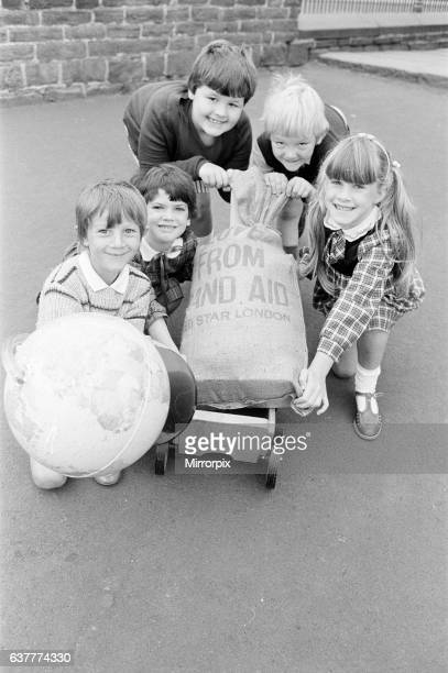 Packing off food for Africa are Linthwaite Church Junior and Infants' School youngsters Nikki Parker Lucy Batley Naomi Roberts Noel Tidbury and Lucy...