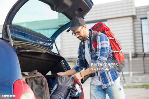 packing on airport - car trunk stock pictures, royalty-free photos & images
