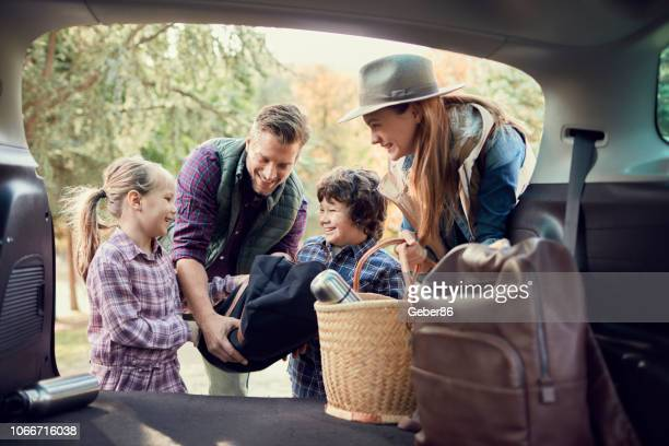 packing - family vacation stock pictures, royalty-free photos & images
