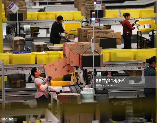BRAMPTON ON NOVEMBER 24 Packing stations box up the product ready for shipping One of 4 Amazon Fulfilment Centres is geared up and firing on all...