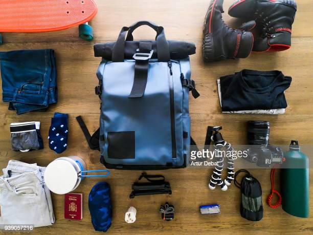 packing the backpack getting ready to going for a travel. - apparatuur stockfoto's en -beelden