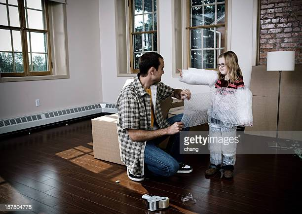 packing the kid - crazy dad stock photos and pictures