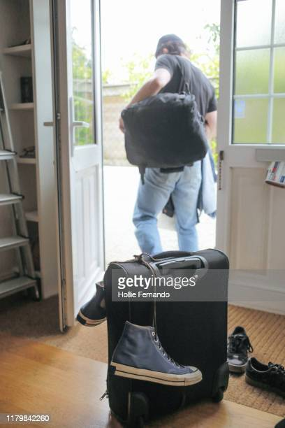 packing to leave for holiday - getting out stock pictures, royalty-free photos & images