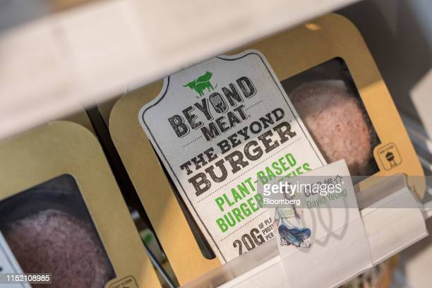 Packs of Beyond Meat Inc. Plant-based burger patties are displayed for sale at a Green Common plant-based grocery store, operated by Green Monday, in...