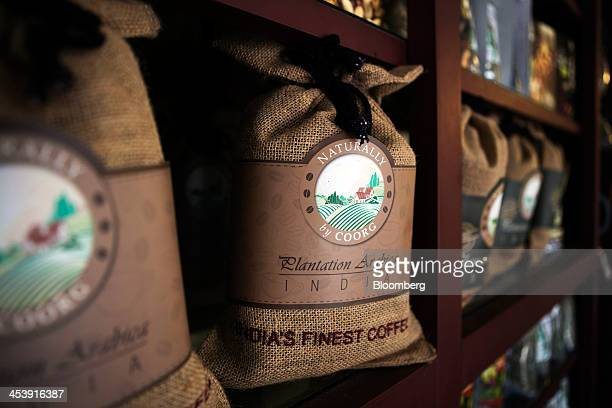 Packs of 'Naturally by Coorg' arabica coffee are displayed for sale at a coffee store in Madikeri Karnataka India on Tuesday Dec 3 2013 Strong...