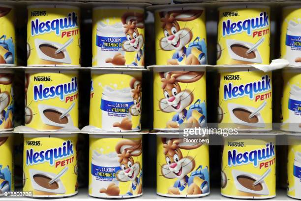 Packs of Nesquik petit yogurt stand on display in a shop at the Nestle SA headquarters in Vevey Switzerland on Thursday Feb 15 2018 Since taking over...