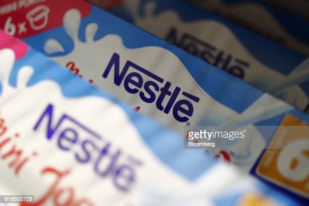 Packs of Nestle yogurt stand on display in a shop at the Nestle SA headquarters in Vevey Switzerland on Thursday Feb 15 2018 Since taking over about...