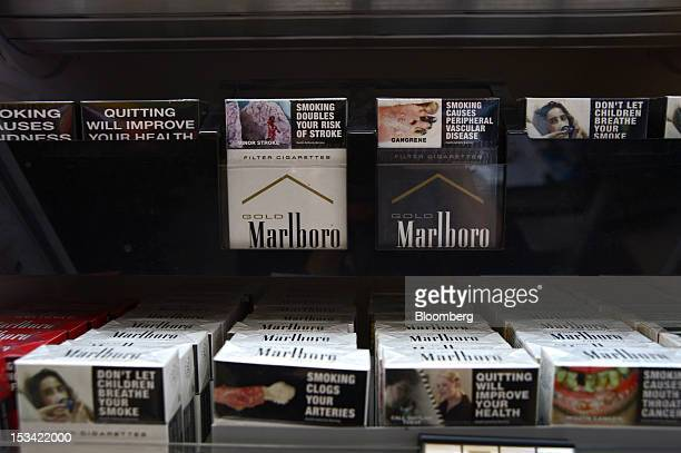 Packs of Philip Morris International Inc Marlboro cigarettes in the new packaging top row first and second left and old packaging are displayed on...