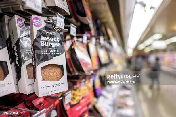Packs of precocked insect burgers based on proteinrich mealworm are seen on a supermarket shelf on August 21 2017 in Geneva Switzerland's first...