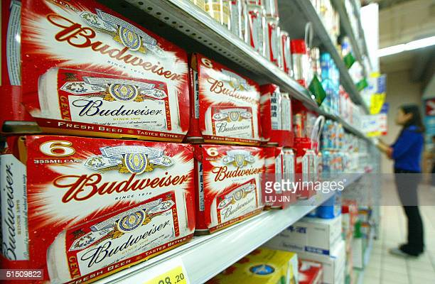 Packs of US brand Budweiser beers are displayed in a Shanghai's supermarket, 20 October 2004. US-based Anheuser-Busch, the world's largest brewer and...