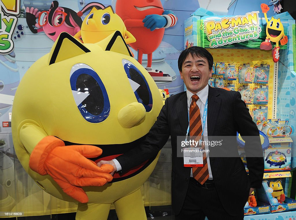 Pac-Man and Bandai Japan Toy Business Strategy Director Akihiro Sato (R) joins opening ceremonies at Toy Fair to celebrate the launch of new Pac-Man Toys from Bandai of America, based on the upcoming Disney XD animated series 'PAC-MAN and the Ghostly Adventures'>> at Jacob Javitz Center on February 10, 2013 in New York City.