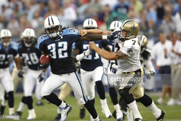 Pacman Jones of the Titans fights off a tackle during action between the New Orleans Saints and the Tennessee Titans at LP Field in Nashville,...