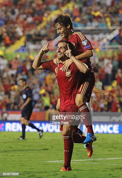 Paco Alcacer celebrates with David Silva after scoring Spain's 2nd goal during the UEFA EURO 2016 Group C Qualifier between Spain and FYR of...