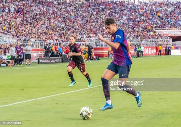 Paco Alcacer Forward FC Barcelona moves for a pass during the International Champions Cup match between AC Milan and FC Barcelona on Saturday August...