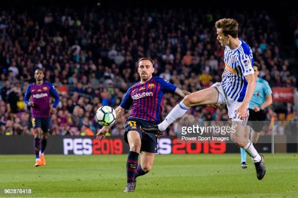 Paco Alcacer Garcia of FC Barcelona fights for the ball with Diego Javier Llorente of Real Sociedad during the La Liga match between Barcelona and...