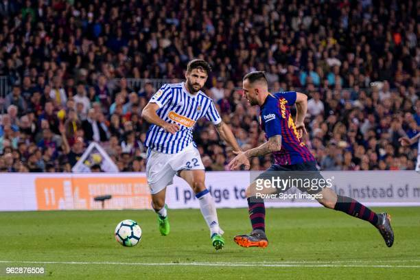 Paco Alcacer Garcia of FC Barcelona fights for the ball with Raul Rodriguez Navas of Real Sociedad during the La Liga match between Barcelona and...