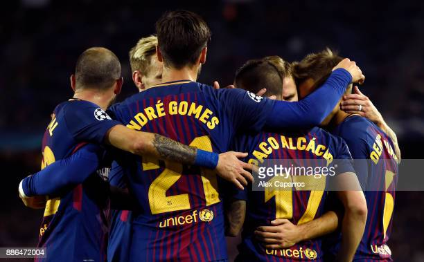 Paco Alcacer of Barcelona celebrates after scoring his sides first goal with his Barcelona team mates during the UEFA Champions League group D match...