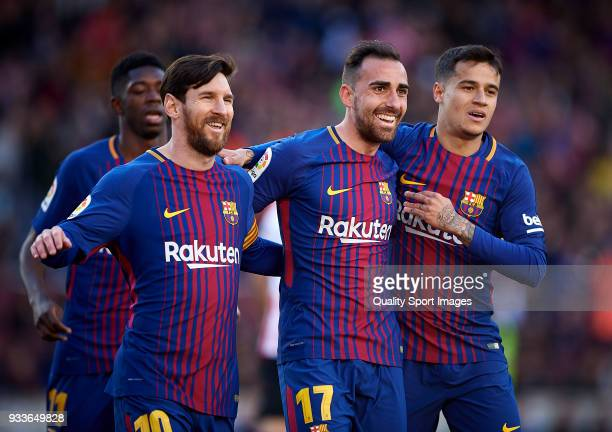 Paco Alcacer of Barcelona celebrates with Lionel Messi and Philippe Coutinho of Barcelona after scorin a goal during the La Liga match between...