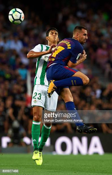 Paco Alcacer of Barcelona competes for the ball with Aissa Mandi of Betis during the La Liga match between Barcelona and Real Betis at Camp Nou on...
