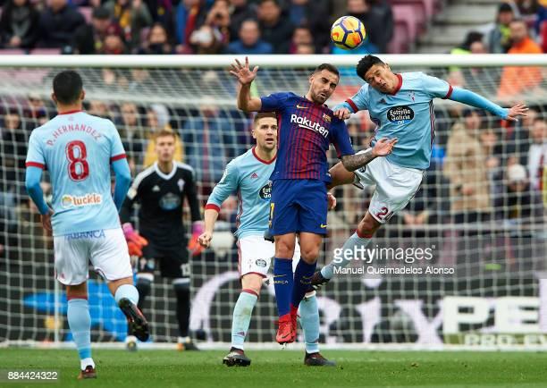 Paco Alcacer of Barcelona competes for the ball with Facundo Roncaglia of Celta during the La Liga match between Barcelona and Celta de Vigo at Camp...