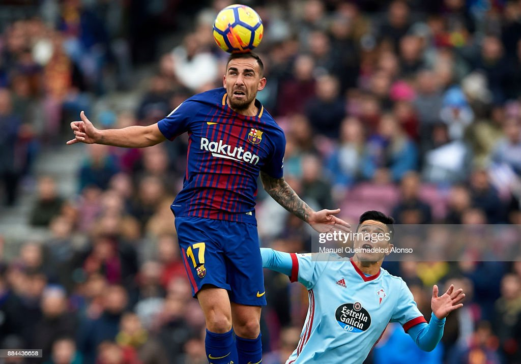 Paco Alcacer (L) of Barcelona competes for the ball with Facundo Roncaglia of Celta during the La Liga match between Barcelona and Celta de Vigo at Camp Nou on December 2, 2017 in Barcelona, Spain.