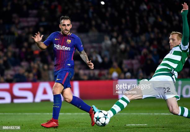 Paco Alcacer of Barcelona shoots and Jeremy Mathieu of Sporting Lisbon deflects it in for a own goal and Barcelona's second goal during the UEFA...