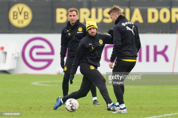 Paco Alcacer of Borussia Dortmund and Marco Reus of Borussia Dortmund battle for the ball during a training session at BVB training center on...