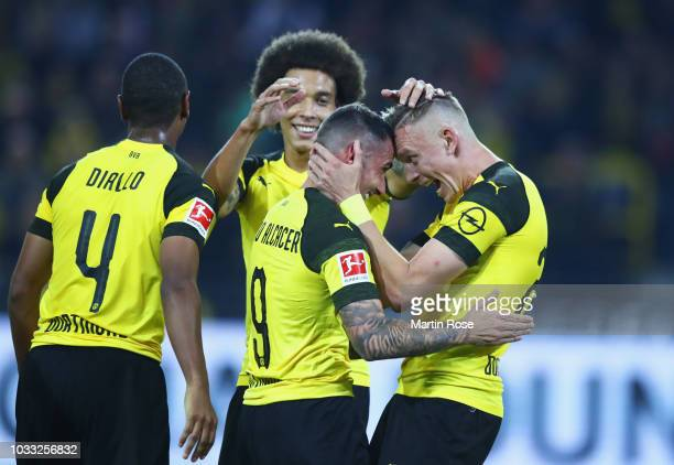 Paco Alcacer of Borussia Dortmund celebrates after scoring his team's third goal with Marius Wolf of Borussia Dortmund during the Bundesliga match...